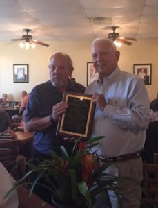 Mr. Bill Hadesty, current Chairman of the Board of Brunswick Family Assistance, presents a plaque to Fred Stephens in recognition of his outstanding service.
